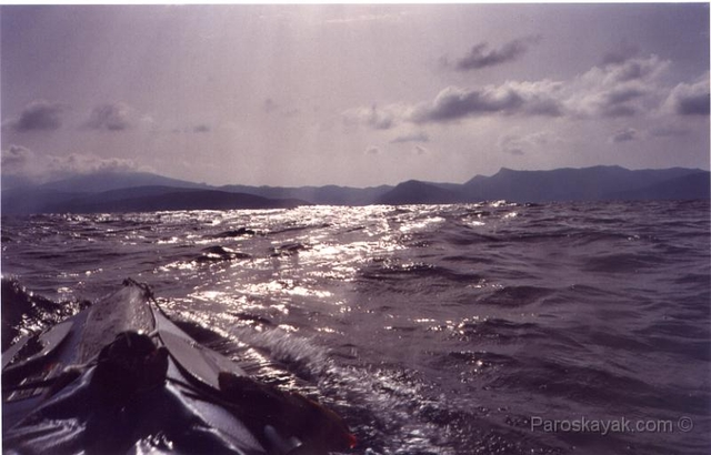 The bow is slashing through the waves off the coast of Amorgos island